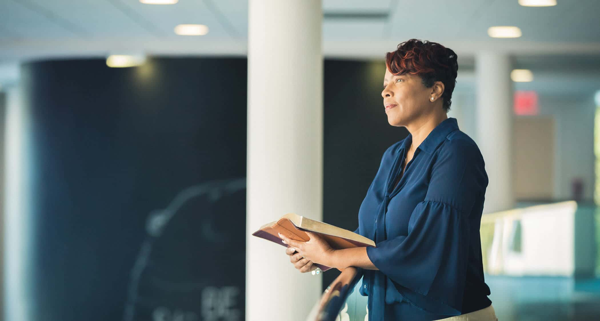 A lady with an open book: Regent University's School of Divinity offers an MDiv degree program.